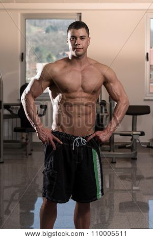 Young Man Flexing Muscles