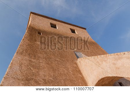 Old medieval watch tower with cloudy sky