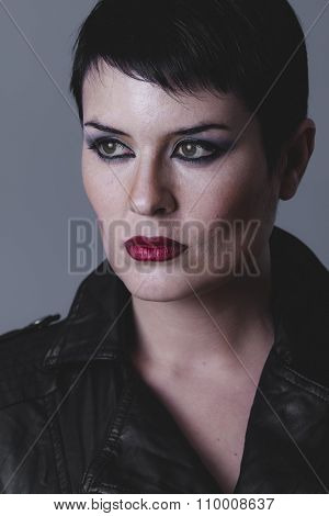 fashion, serious gesture girl dressed in black leather jacket