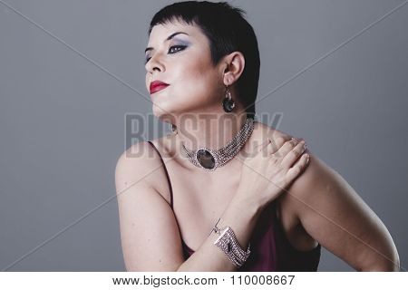 classic, dancer flapper with short black hair and jewelry