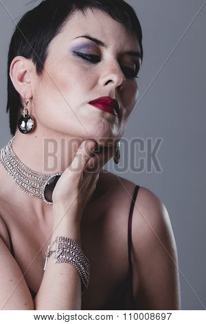 fashioned, sexy girl with jewelry and style of the 20s