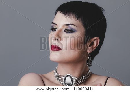 diamond, flapper dancer with dark short hair and jewelry