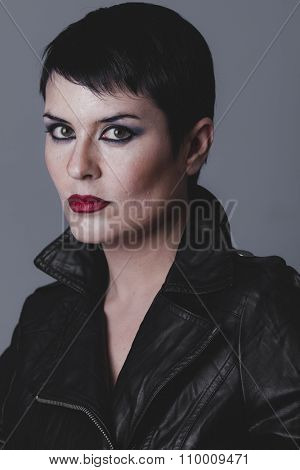 wild, serious gesture girl dressed in black leather jacket
