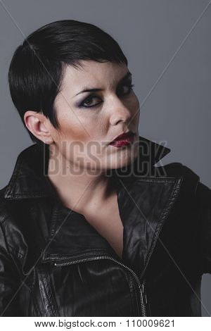 female, serious gesture girl dressed in black leather jacket