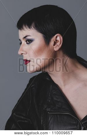 rock, serious gesture girl dressed in black leather jacket