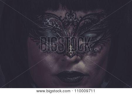 Sad, portrait of woman with black mask thread Venetian