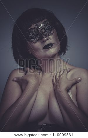 Nude portrait of woman with black mask thread Venetian