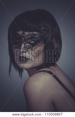 Desire, portrait of woman with black mask thread Venetian