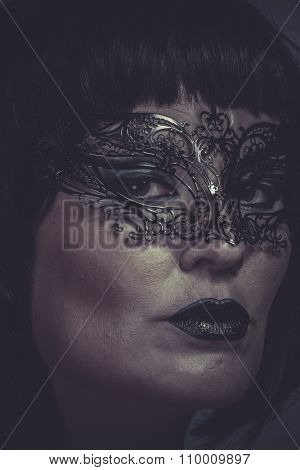 Look, portrait of woman with black mask thread Venetian
