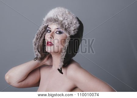beautiful nude woman with furry winter hat girl cold