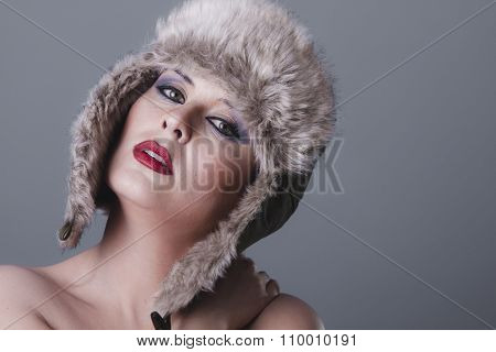 clothing naked girl with Russian winter hat, cold