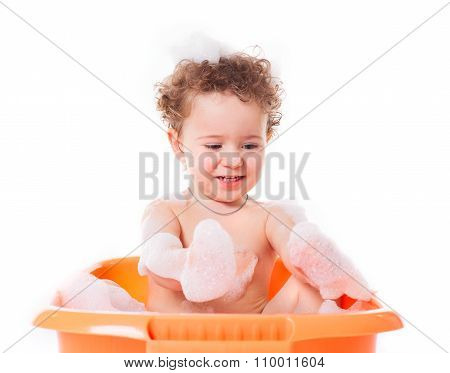 Cute Happy Baby Playing With Foam In Bath