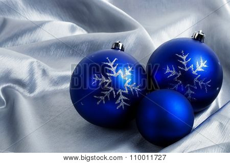 Christmas balls on a silver background