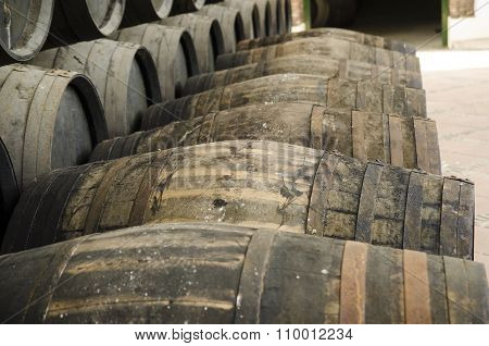 Barrels For Whiskey Or Wine Stacked In Outdoor