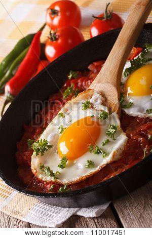 Huevos Rancheros: Fried Egg With Salsa Closeup In The Pan. Vertical