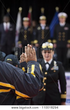 NEW YORK - NOV 25 2015: Rear Admiral Cynthia M. Thebaud, Commander, Expeditionary Strike Group 2 swears in new recruits to the US Navy during the Americas Parade up 5th Avenue on Veterans Day.