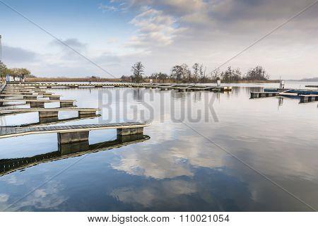 Deserted Ship Docks In The Port