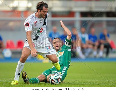 VIENNA, AUSTRIA - SEPTEMBER 20, 2014: Nemanja Rnic (#15 Wolfsberg) and Steffen Hofmann (#11 Rapid) fight for the ball in an Austrian soccer league game.
