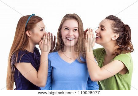 Portrait Of Three Happy Caucasian Females Sharing Secrets And Rumoring To Each Other To Ears