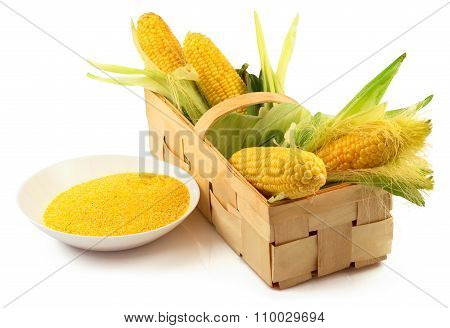 Ripe Corn With Green Leaves In The Wooden Box And A Plate Of Maize Flour