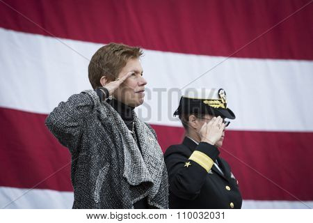 NEW YORK - NOV 25 2015: Army vet Loree Sutton Commissioner of NYC Office of Veterans Affairs and Rear Admiral Cynthia M. Thebaud salute for the presentation of colors on the Intrepid on Veterans Day.