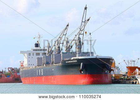 PORT LOUIS, MAURITIUS ISLAND - OCTOBER 30, 2015: Modern Bulk carrier  IVS Crimson Creek from Singapore, built 2014, size 190 x 32 m, gross tonnage 32750 t, deadweight 57945 t.