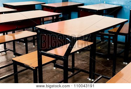 Wooden benches in a classroom