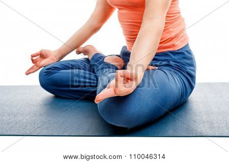 Close up of of yogini woman in yoga asana Padmasana (Lotus pose) cross legged position for meditation with Chin Mudra - psychic gesture of consciousness isolated on white background with copyspace poster
