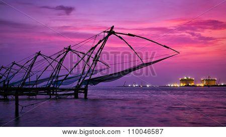 Panorama of tourist attraction of Kochi - chinese fishnets on sunset. Fort Kochin, Kochi, Kerala, India