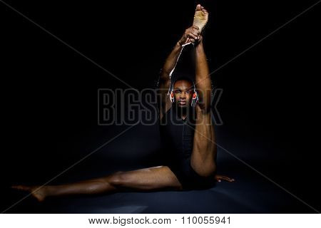 Dancer Stretching on the Floor