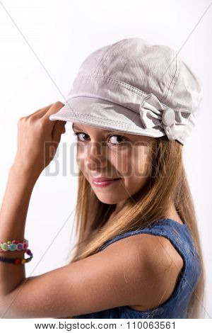 Young Girl Posing With A Hat