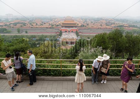 BEIJING - CIRCA JUNE , 2015: Tourists on a viewing platform in the Jingshan park. Observation desk Jingshan Park is the highest point of the old Beijing, it offers view of the Imperial Forbidden City