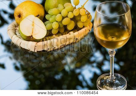 Ripe Appetizing Grape, Pears And Glass Of Wine