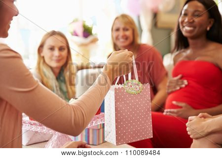 Close Up Of Gift For Pregnant Woman At Baby Shower