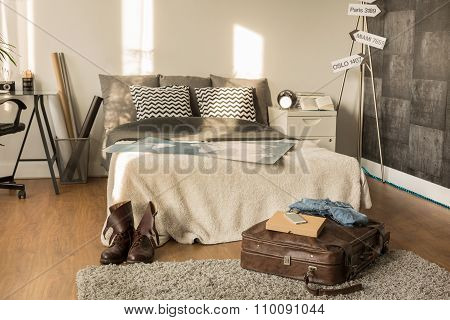 Traveler Bedroom With Decorative Signpost