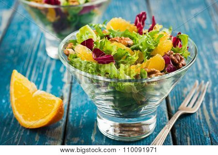 Healthy Salad Mix With Orange And Walnuts In Glass