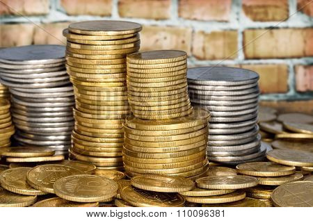 Folded stack of coins of yellow and white metal poster