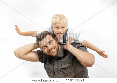 Father and son playing on the field