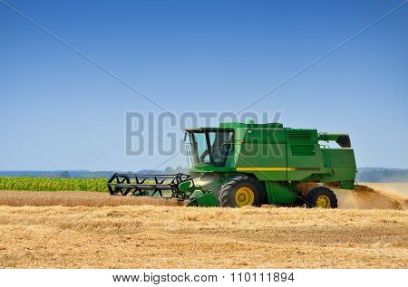 Agricultural Machinery Harvests Of Cereal Crops In The Field