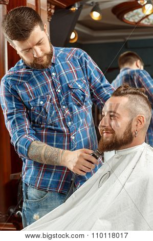 Man getting his beard shaved in a barber shop