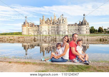 Happy Family On Chambord Chateaux, Enjoying Summer Holiday