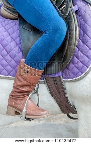 feet in stirrups