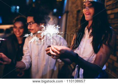 Young Friends Celebrating With Sparklers