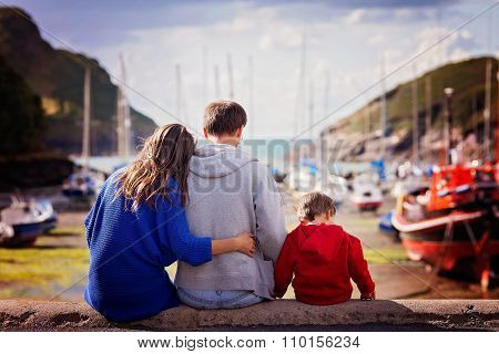 Young Family With Small Kids On A Harbor In The Afternoon