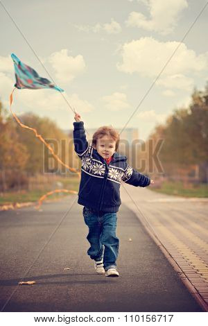 Boy, Running With Kite In The Park