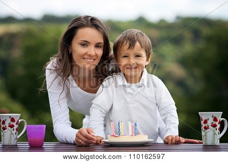 Mother And Boy, Celebrating His Birthday Outdoor