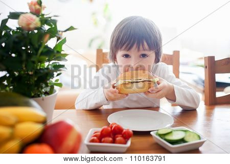 Beautiful Little Boy, Eating Sandwich At Home, Vegetables On The Table