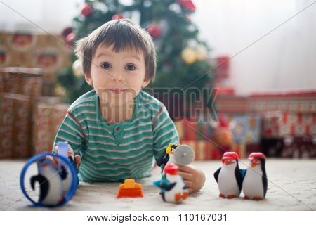 Little Cute Boy, Playing With Toys From Presents On Christmas Day