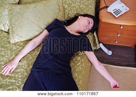 Girl lying unconscious next to the handset out