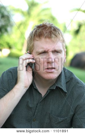 Man On The Phone With A Angry Or Confused Expression